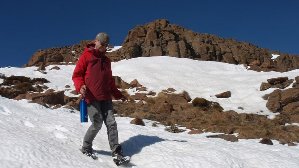 Hiker in snow on Mont aux sources
